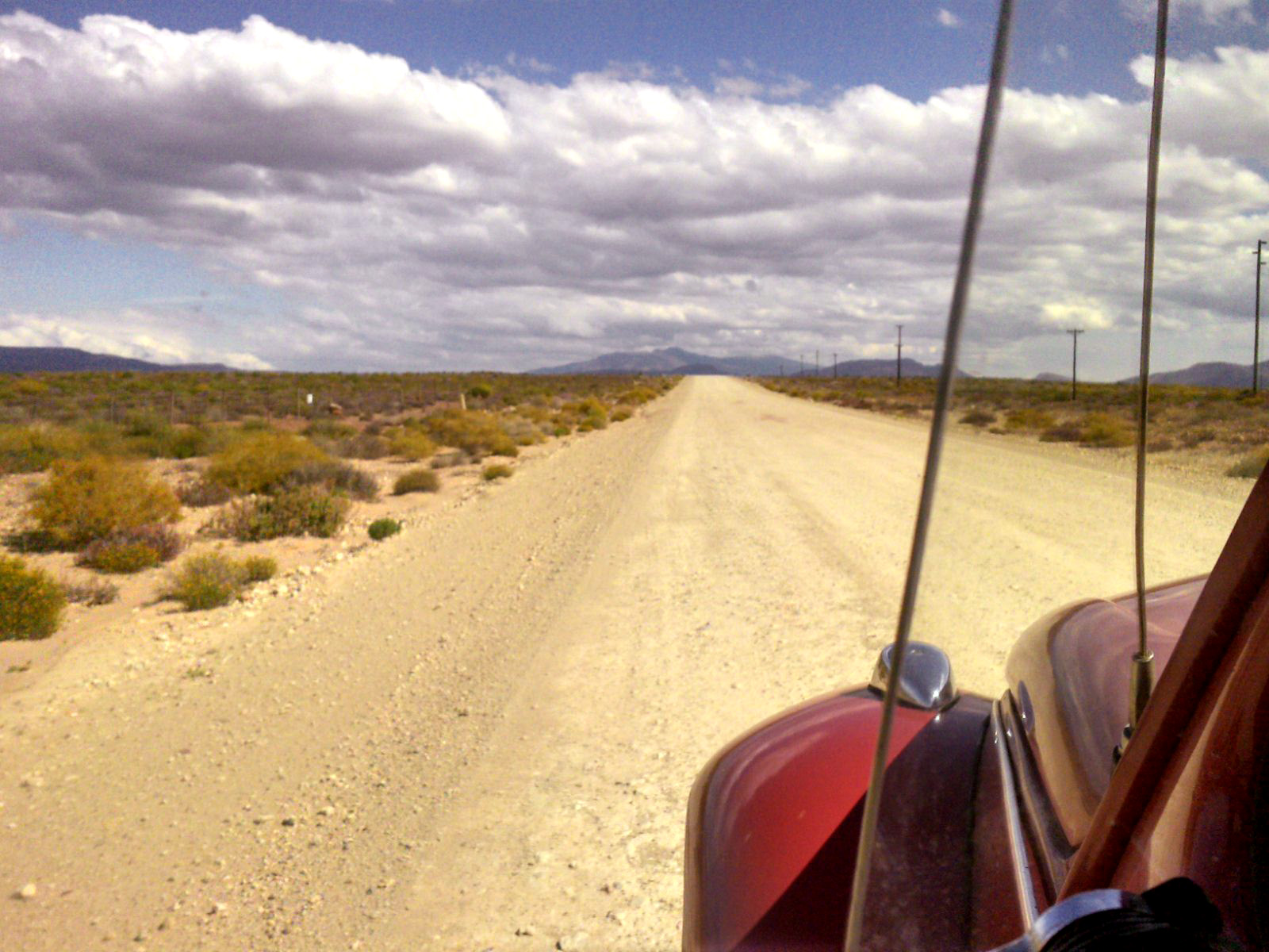 Oldtimer driving on a desert road